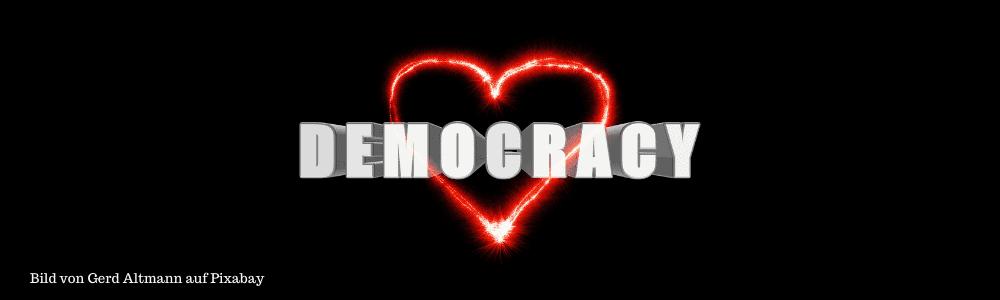 rotes Herz mit Schriftzug Democrcy